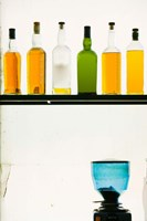Bottles displayed at the Bookworm Cafe, Sanlitun, Chaoyang District, Beijing, China Fine-Art Print