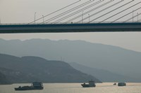 Container ships passing a newly constructed bridge on the Yangtze River, Wanzhou, Chongqing Province, China Fine-Art Print