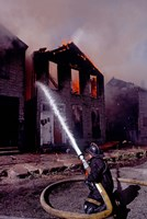 Firefighter during a rescue operation, USA Fine-Art Print