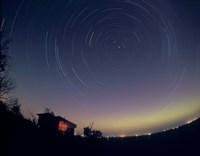 Circumpolar star trails with a faint aurora over horizon, Alberta, Canada Fine-Art Print