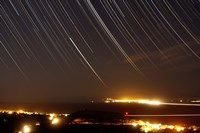Star trails above a village in the central desert of Iran Fine-Art Print