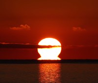 An omega-shaped sunrise above the water in Buenos Aires, Argentina Fine-Art Print