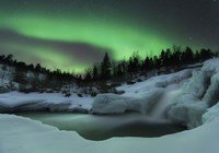 A wintery waterfall and aurora borealis over Tennevik River, Norway Fine-Art Print