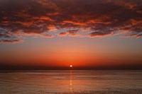 A layer of clouds is lit by the rising sun over Rio de la Plata, Buenos Aires, Argentina Fine-Art Print