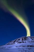 An aurora borealis shooting up from Toviktinden Mountain, Norway Fine-Art Print