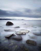 Long exposure scene of rocks in Vaagsfjorden fjord, Norway Fine-Art Print