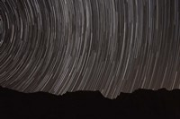 Star trails above a valley in the Firoozkooh area, Iran Fine-Art Print