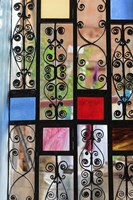 Africa, Tanzania, Zanzibar, Stone Town. Stained glass and iron door. Fine-Art Print
