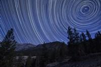 Star trails above mountain peaks near Yosemite National Park, California Fine-Art Print