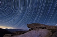 Star trails and a granite rock outcropping overlooking Anza Borrego Desert State Park Fine-Art Print