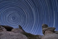 A boulder outcropping and star trails in Anza Borrego Desert State Park, California Fine-Art Print