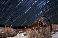 Abandoned farm equipment against a backdrop of star trails Fine-Art Print
