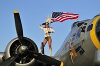 1940's style majorette pin-up girl on a B-17 bomber with an American flag Fine-Art Print
