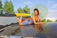 1940's style pin-up girl with parasol on a vintage P-51 Mustang Fine-Art Print