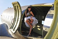 Sexy 1940's style pin-up girl standing inside of a C-47 Skytrain aircraft Fine-Art Print