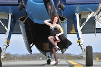 1940's style pin-up girl in cocktail dress posing in front of a TBM Avenger Fine-Art Print