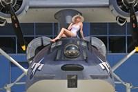 Retro pin-up girl posing with a World War II era PBY Catalina seaplane Fine-Art Print