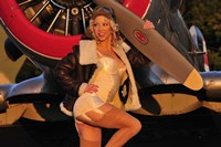 1940's pin-up girl posing with a vintage T-6 Texan aircraft Fine-Art Print