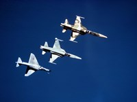 Two F-5 Tiger II's and an A-4E Skyhawk in flight above the Pacific Ocean Fine-Art Print