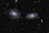 Gravitionaly distorted Galaxies NGC 3169 and NGC 3166 Fine-Art Print