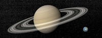 Large planet Saturn and its rings next to small planet Earth Fine-Art Print