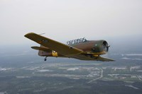 North American Aviation T-6 Texan trainer warbird in Norwegian Air Force colors Fine-Art Print