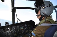 Pilot in the cockpit of a CH-46 Sea Knight helicopter of the Swedish Air Force Fine-Art Print