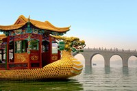 The Summer Palace, a traditional Dragon Boat passes the Seventeen Arch Bridge, Kunming lake, Beijing, China Fine-Art Print