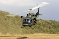 An Italian Air Force AB-212 ICO helicopter departs the landing zone, Italy Fine-Art Print
