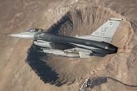 F-16C Fighting Falcon flying above Arizona's Meteor Crater Fine-Art Print