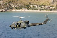 Italian Air Force AB-212 ICO helicopter in flight over Italy Fine-Art Print