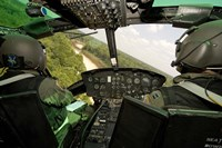 Two instructor pilots practice low flying operations in a UH-1H Huey helicopter Fine-Art Print