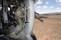 A HH-60G Pave Hawk gunner fires his GAU-17 machine gun Fine-Art Print