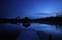 A small pier in a lake against starry sky, Moscow region, Russia Fine-Art Print