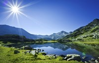 Muratov Lake against blue sky and bright sun in Pirin National Park, Bulgaria Fine-Art Print