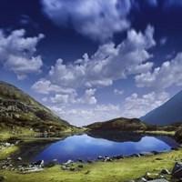 Blue lake in the Pirin Mountains over tranquil clouds, Pirin National Park, Bulgaria Fine-Art Print