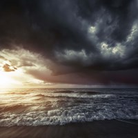 Bright sunset against a wavy sea with stormy clouds, Hersonissos, Crete Fine-Art Print