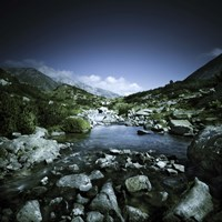 Small river flowing through big stones in Pirin National Park, Bulgaria Fine-Art Print