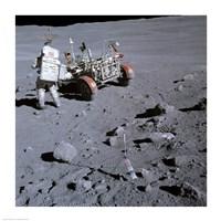 Astronaut walking near the lunar rover on the moon, Apollo 16 Fine-Art Print