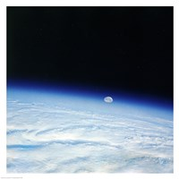 Outer space shot of storm system in early stage of formation with moon in background Fine-Art Print