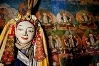 Religious statue infront of Buddha mural at Shey Palace, Ladakh, India Fine-Art Print