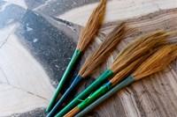 India, Jammu and Kashmir, Ladakh, Leh, brooms in a Buddhist temple Fine-Art Print