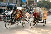 People and cargo move through streets via rickshaw, Varanasi, India Fine-Art Print