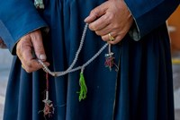 Woman's hands holding prayer beads, Ladakh, India Fine-Art Print