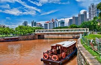 Singapore skyline and tug boats on river. Fine-Art Print