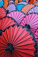 Pattern of newly assembled decorative umbrellas drying in sun, Umbrella Making Center, Bo Sang, near Chiang Mai, Thailand. Fine-Art Print