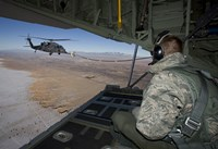 Loadmaster on an HC-130 Watches a HH-60G Pave Hawk Refuel Fine-Art Print