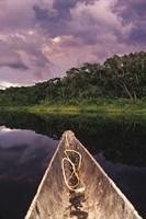 Paddling a dugout canoe on Lake Anangucocha, Yasuni National Park, Amazon basin, Ecuador Fine-Art Print
