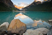Rocky Mountains and boulders reflected in Lake Louise, Banff National Park, Alberta, Canada Fine-Art Print