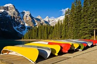 Moraine Lake and rental canoes stacked, Banff National Park, Alberta, Canada Fine-Art Print